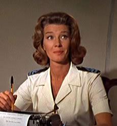 Lois Maxwell as Miss Money Penny