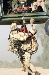US Air Force (USAF) Pararescue personnel assigned to Baghdad International Airport (BIAP), perform a hoist extraction of a survivor during an Urban Operations Training Exercise (UOTE) at the Maltz training site, in support of Operation IRAQI FREEDOM.