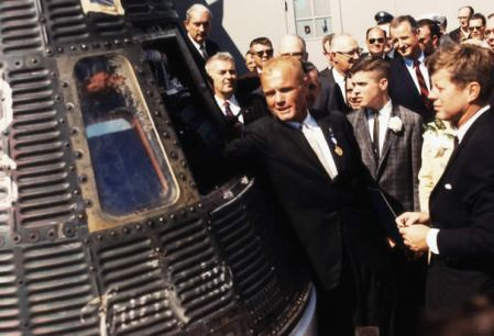 john-glenn-shows-president-kennedy-the-mercury-space-capsule-he-rode-in-to-orbit-the-earth