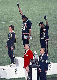 220px-John_Carlos,_Tommie_Smith,_Peter_Norman_1968cr